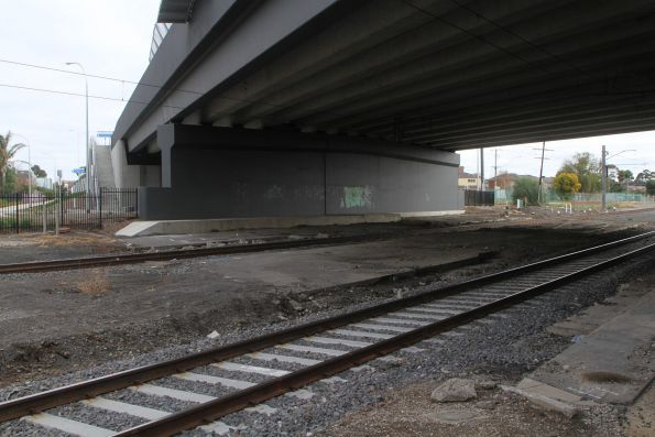 Sections of road still visible beneath the new bridge