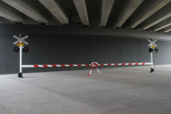 Artwork titled 'Leveled Crossing' by Jason Waterhouse beneath the eastern approach span