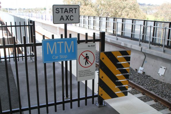 'MTM Car Stop' and 'Start AXC' signs at the up end of Mernda station