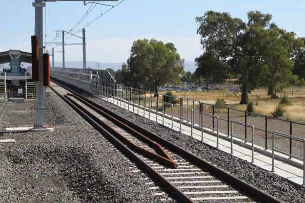 Short section of guard rails protect the approach embankment to the Mernda station U channel viaduct
