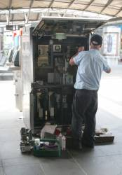 Both panels open while repairing a MVM2 ticket machine