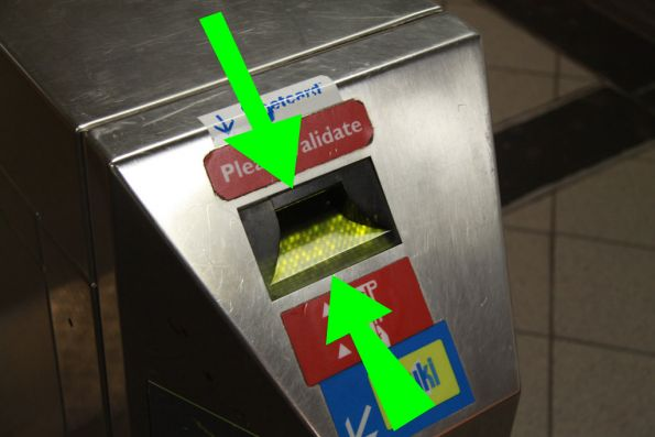 The green arrows mark where you DON'T want to put your Metcard, right between the plastic ticket guides and the metal body.