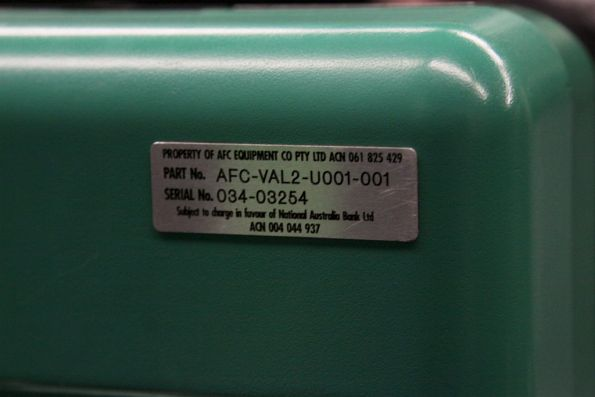 Serial number plate on the rear of a Metcard validator