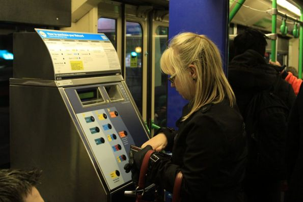 Diehard Metcard users pumping coins into the vending machines onboard trams