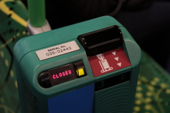Metcard validator onboard a tram, the early-2000s 'insert here' sticker still in place