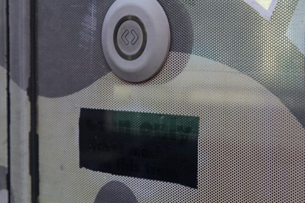Remains of a 'Coin only ticket machine' sticker on the door of a C2 class tram