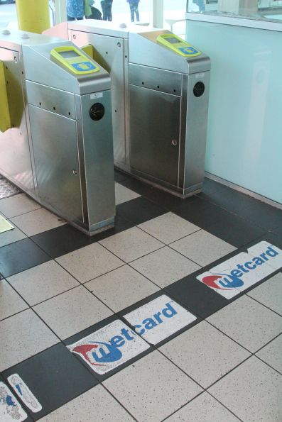 Remnant Metcard branding beneath the Myki gates at Dandenong station