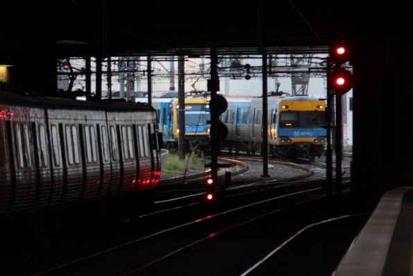 Comeng train closing in on a delayed train at Southern Cross platform 10
