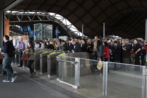 Slow Myki gates cause a queue to exit Southern Cross at the Bourke Street end