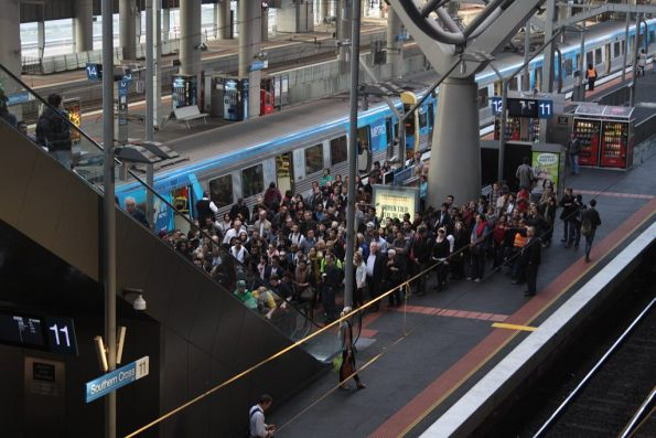 Escalators struggling to clear the crowds at Southern Cross platform 12