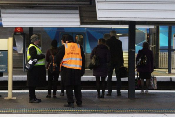 Metro Trains customer service staff beside a contracted first aid officer at Richmond station