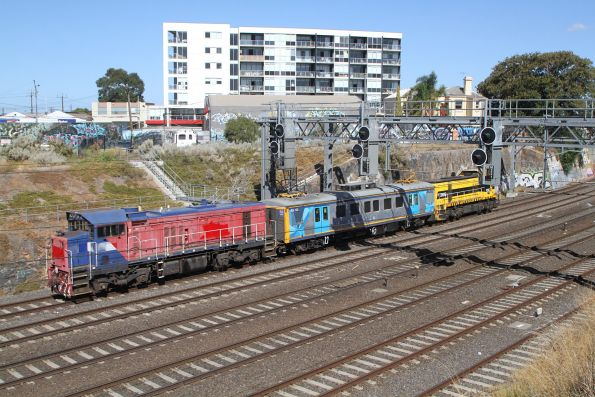 P18 trails T385 through Footscray on an inspection run bound for Werribee