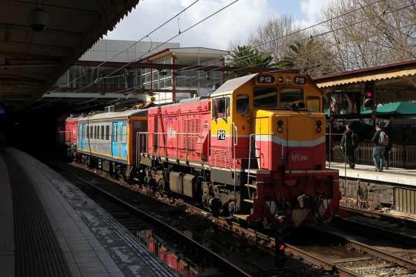 V/Line's P12 and P15 lead IEV102 through Flinders Street on an inspection run from Cheltenham to Sunbury