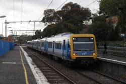 X'Trapolis 163M arrives into Gardiner station with an up Glen Waverley service, as grade separation works continue alongside