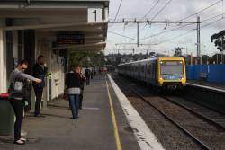 X'Trapolis arrives into Gardiner station with a down Glen Waverley service, as grade separation works continue alongside
