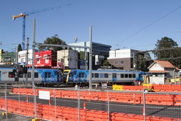X'Trapolis 198M and 961M cross the tram square at Gardiner station
