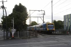 X'Trapolis 69M leads a down Lilydale train out of Blackburn