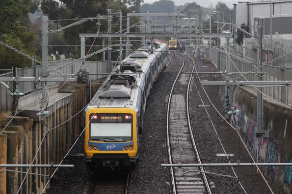 Up and down X'Trapolis trains pass between Rooks Road and Nunawading station