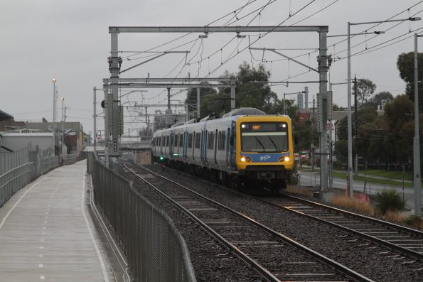X'Trapolis train between Rooks Road and Nunawading with an up service