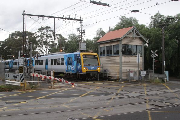 X'Trapolis 862M crosses the tram square at Riversdale with a down Alamein service
