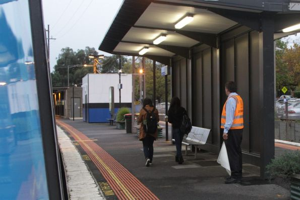 Station staff at Surrey Hills watch for intending passengers before waving the white 'all clear' flag to the train driver