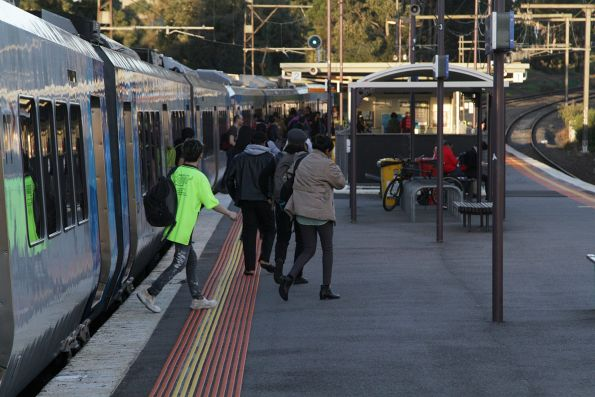 Passengers depart a down Glen Waverley service at Syndal station