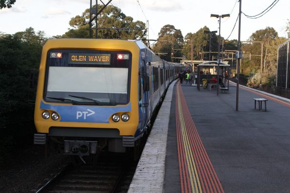 X'Trapolis train departs Syndal with a down Glen Waverley service