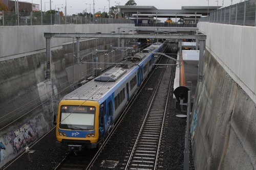 X'Trapolis train approaches Mitcham with a down Lilydale service