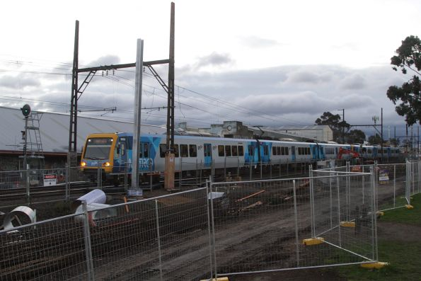 X'Trapolis 96M approaches the soon to be removed level crossing at Blackburn Road