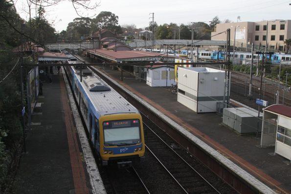 Belgrave bound X'Trapolis train departs Camberwell station