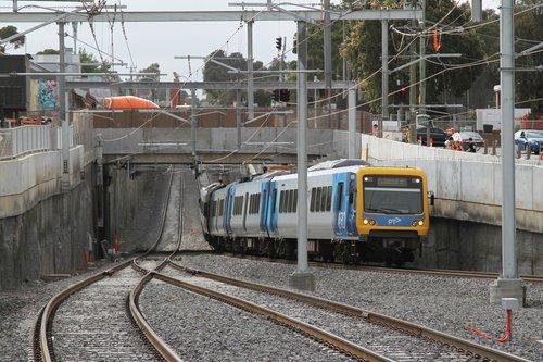 X'Trapolis 105M passes under Blackburn Road, arriving at Blackburn station on the up