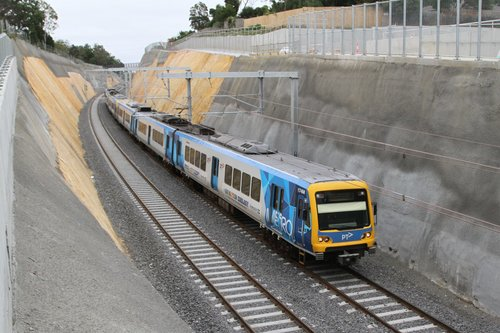 X'Trapolis 174M arrives into the new Heatherdale station with a down service