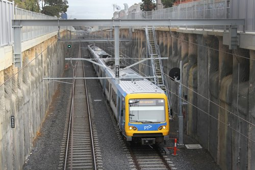 X'Trapolis train midway between Blackburn and Nunawading on a down Belgrave service