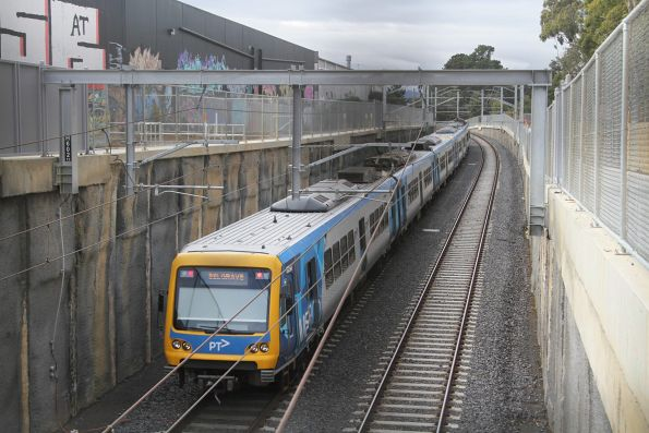 X'Trapolis train heads back to ground level near Nunawading on a down Belgrave service