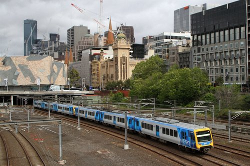 X'Trapolis 209M leads a down service out of Flinders Street