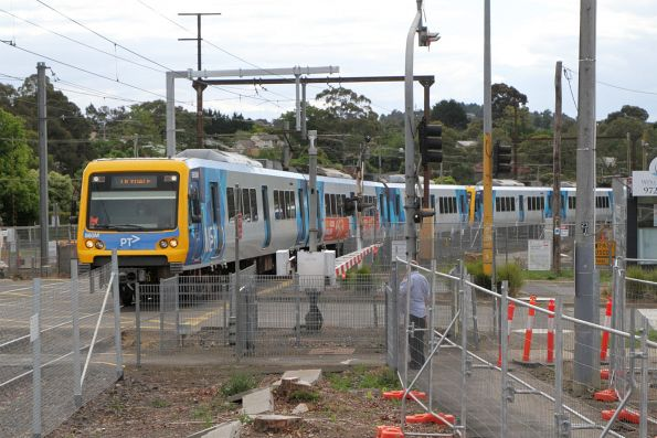 X'Trapolis 860M arrives into Mooroolbark station on a down Lilydale service
