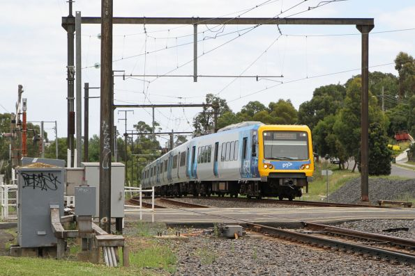 X'Trapolis 48M arrives into Upper Ferntree Gully on a down Belgrave service