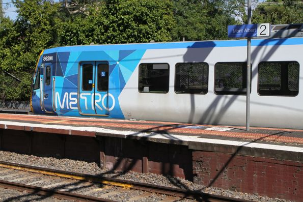 X'Trapolis train pauses at Mont Albert platform 3, just a wedge of island platform available for intending passengers