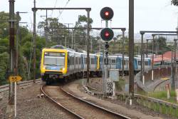 X'Trapolis 31M departs Upper Ferntree Gully on a down Belgrave service