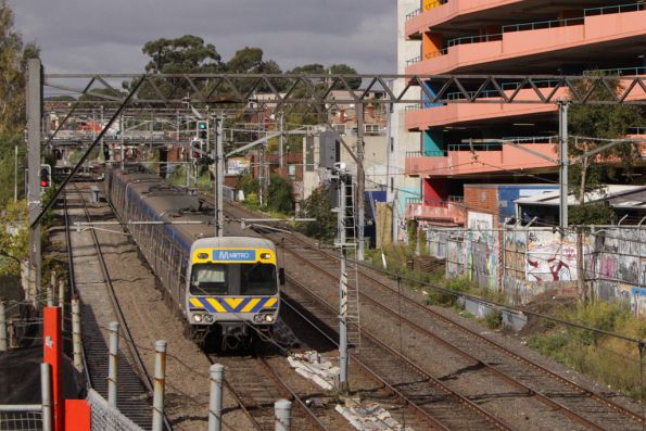 Alstom Comeng on the up passes the Jam Factory at South Yarra