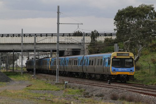 EDI Comeng on an up Cranbourne service passes beneath the Dandenong Bypass overbridge