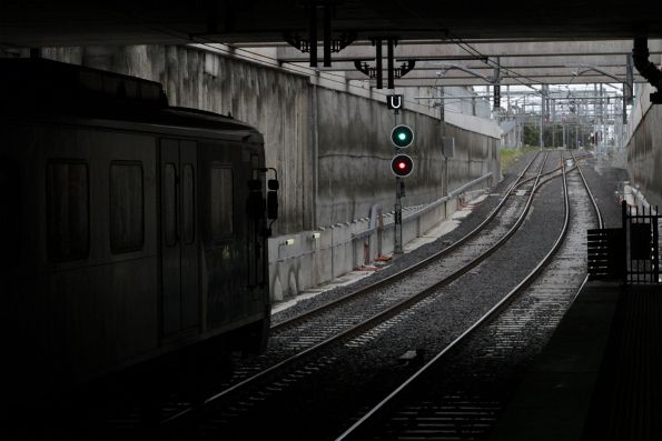 Siemens train departs Springvale with an up service
