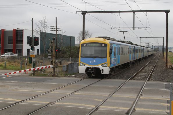 Siemens train departs Hallam with a down Pakenham service