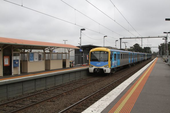 Siemens train departs Hallam with an up Pakenham service