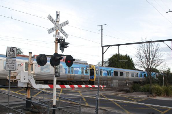 Comeng train passes through the McKinnon Road level crossing on the Frankston line