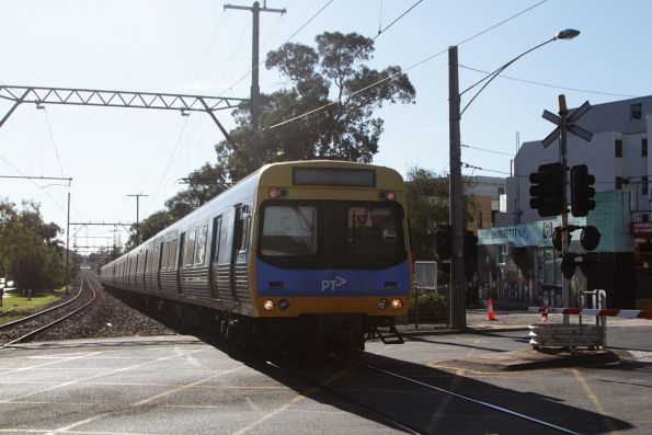EDI Comeng arrives into Hughesdale station on a down Cranbourne service