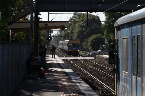 Up and down trains pass at Murrumbeena station