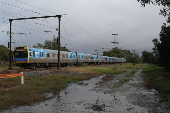 EDI Comeng 552M passes through the countryside between Cardinia Road and Beaconsfield