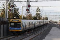 EDI Comeng departs the newly rebuilt low level station at McKinnon with a down Frankston service  on a down Frankston service