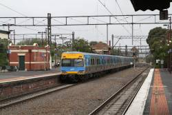 Comeng train departs Caulfield with a down Frankston service